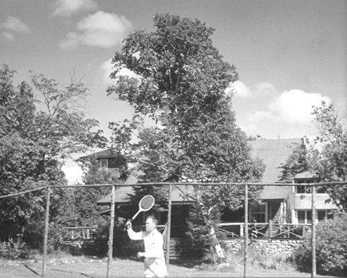Frank Seiberling Jr. playing tennis at Cedar Lodge, 1951
